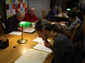 Photograph shows project staff and volunteers doing research.